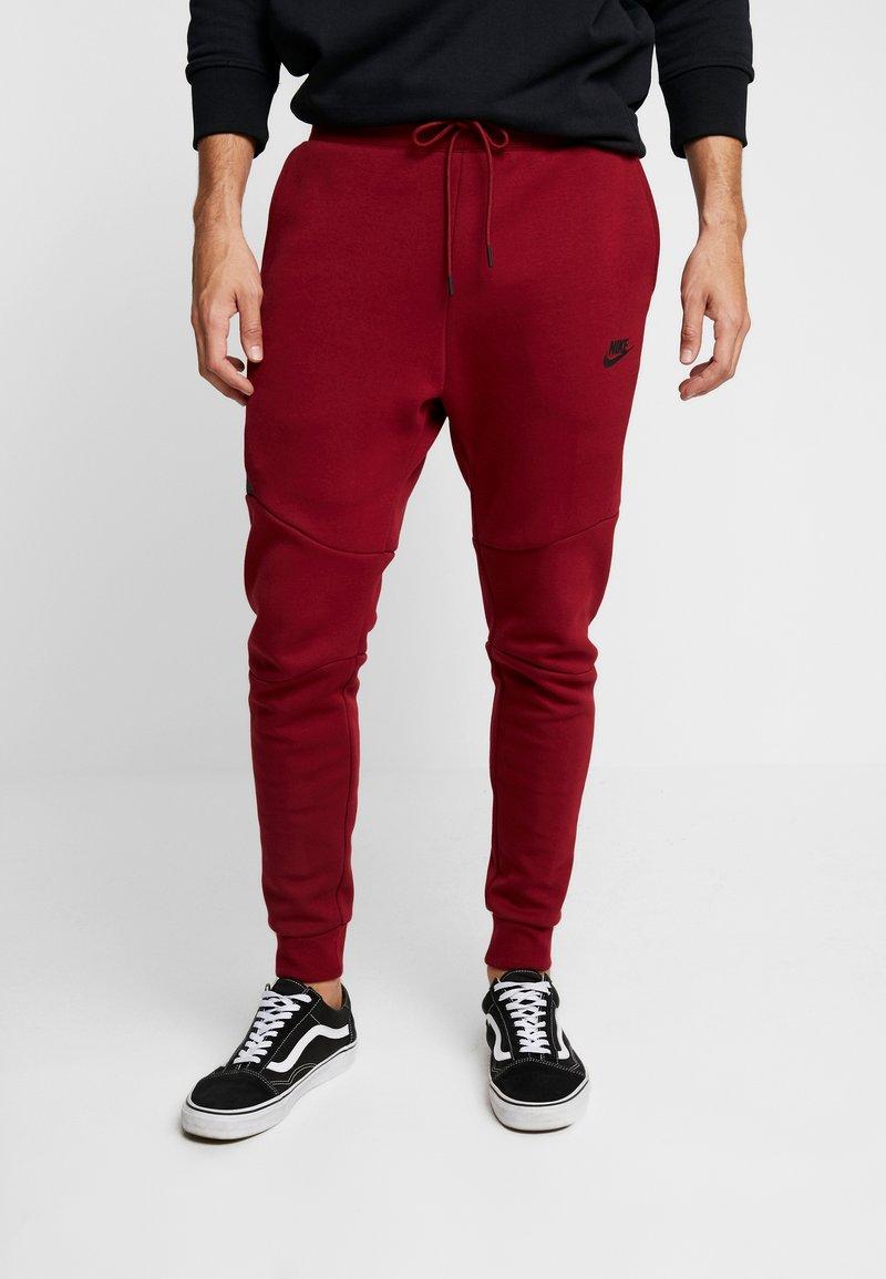 Nike Sportswear - TECH - Tracksuit bottoms - team red/black