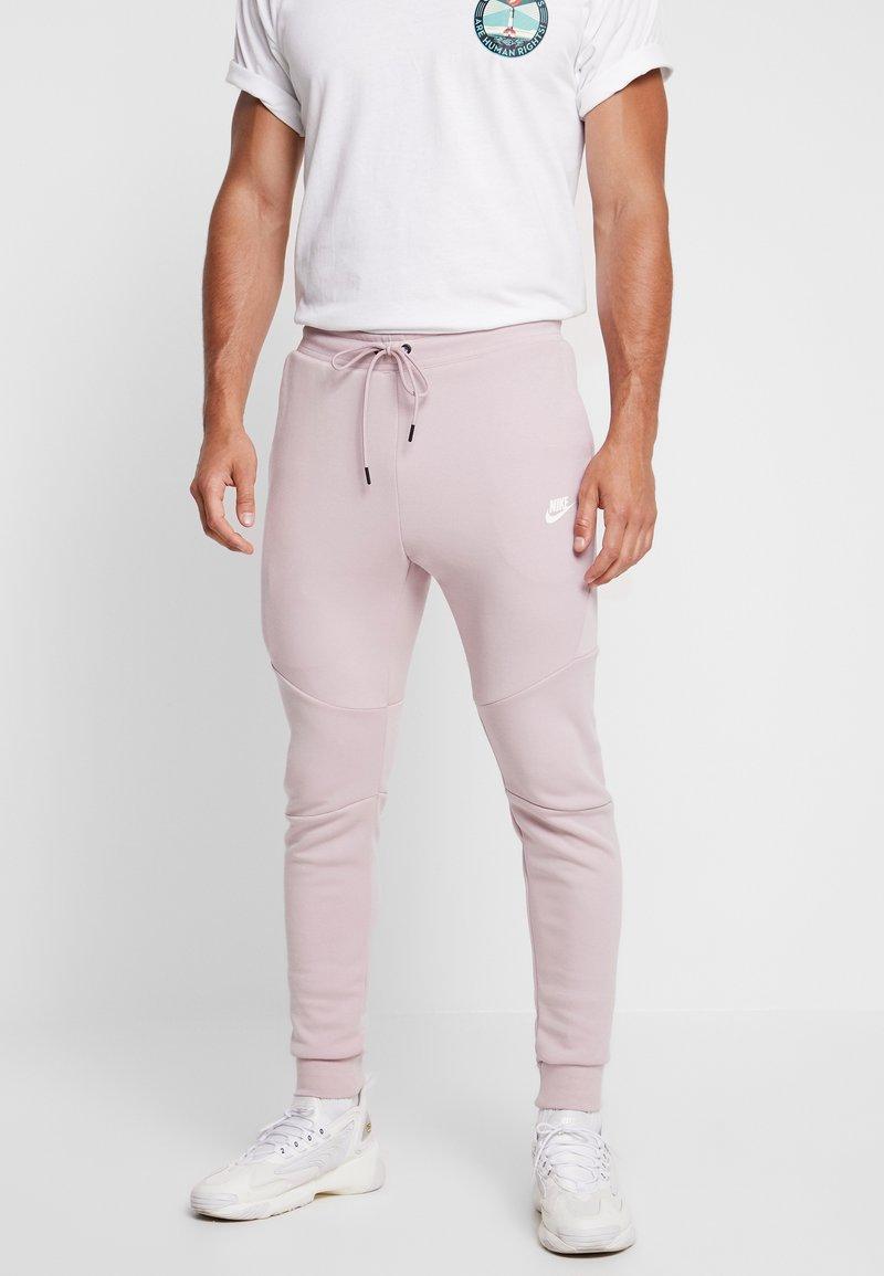 Nike Sportswear - TECH - Tracksuit bottoms - light pink