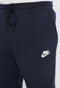 Nike Sportswear - TECH - Pantalon de survêtement - dark blue, white - 3
