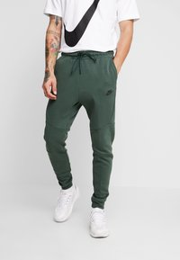 Nike Sportswear - TECH - Verryttelyhousut - galactic jade/black - 0