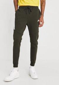 Nike Sportswear - TECH - Spodnie treningowe - sequoia/white - 0