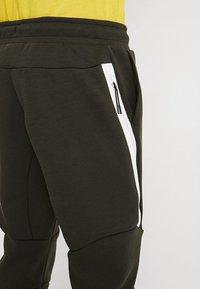 Nike Sportswear - TECH - Spodnie treningowe - sequoia/white - 3