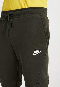 Nike Sportswear - TECH - Spodnie treningowe - sequoia/white - 5