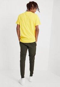 Nike Sportswear - TECH - Spodnie treningowe - sequoia/white - 2