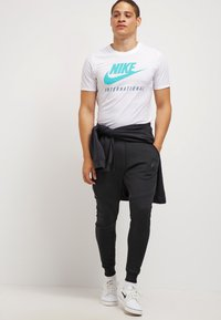 Nike Sportswear - TECH - Jogginghose - black - 1