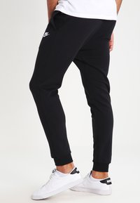 Nike Sportswear - CLUB FRENCH TERRY - Tracksuit bottoms - black/white - 2