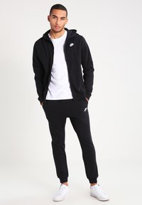 Nike Sportswear - CLUB FRENCH TERRY - Tracksuit bottoms - black/white - 1