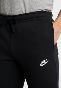 Nike Sportswear - CLUB CUFFED PANT - Tracksuit bottoms - black/white - 5