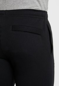 Nike Sportswear - CLUB CUFFED PANT - Tracksuit bottoms - black/white - 3
