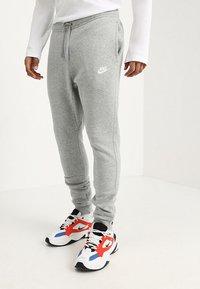 Nike Sportswear - CLUB JOGGER - Tracksuit bottoms - grey - 0