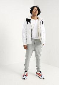 Nike Sportswear - CLUB JOGGER - Tracksuit bottoms - grey - 1