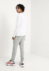 Nike Sportswear - CLUB JOGGER - Tracksuit bottoms - grey - 2