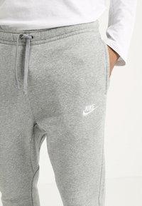 Nike Sportswear - CLUB JOGGER - Tracksuit bottoms - grey - 4