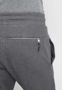 Nike Sportswear - OPTIC - Verryttelyhousut - dark grey/heather - 5