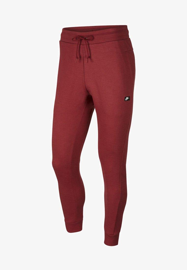 Nike Sportswear - OPTIC - Tracksuit bottoms - dark red