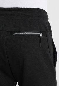 Nike Sportswear - OPTIC - Tracksuit bottoms - black - 5