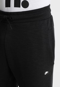 Nike Sportswear - OPTIC - Tracksuit bottoms - black - 3