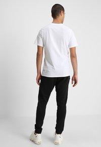 Nike Sportswear - OPTIC - Verryttelyhousut - black - 2