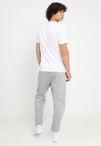 Nike Sportswear - PANT - Trainingsbroek - dark grey heather