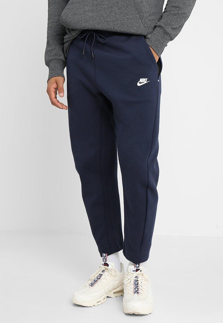 Nike Sportswear - PANT - Tracksuit bottoms - obsidian/white