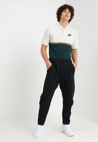 Nike Sportswear - PANT - Trainingsbroek - black/black - 1