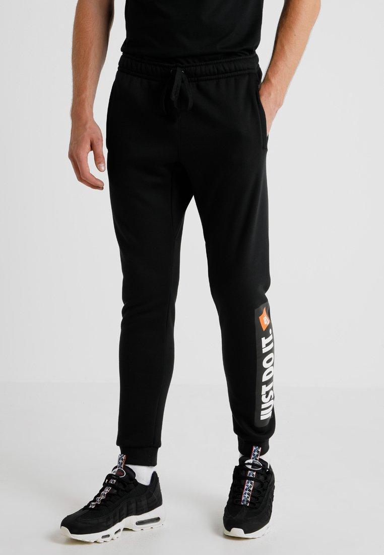 Nike Sportswear - Tracksuit bottoms - black