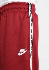 Nike Sportswear - POLY - Verryttelyhousut - team red/white - 4