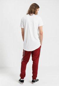 Nike Sportswear - POLY - Verryttelyhousut - team red/white - 2