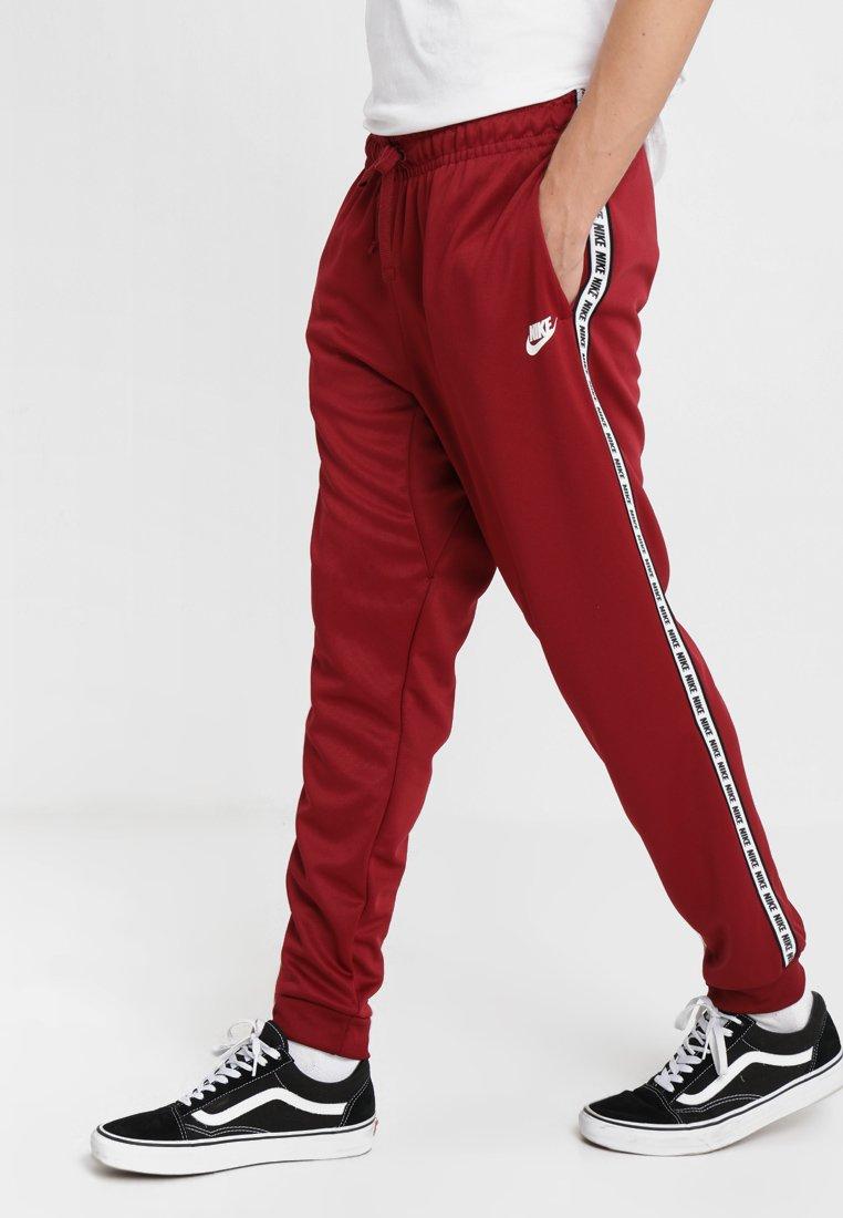 Nike Sportswear - POLY - Verryttelyhousut - team red/white
