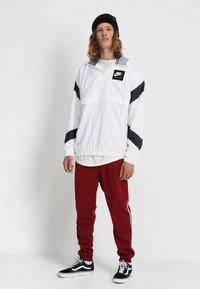 Nike Sportswear - POLY - Verryttelyhousut - team red/white - 1
