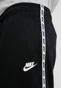 Nike Sportswear - POLY - Pantalon de survêtement - black/white - 3
