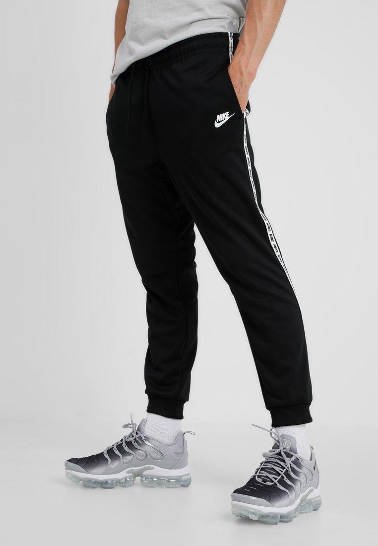 Nike Sportswear - POLY - Tracksuit bottoms - black/white