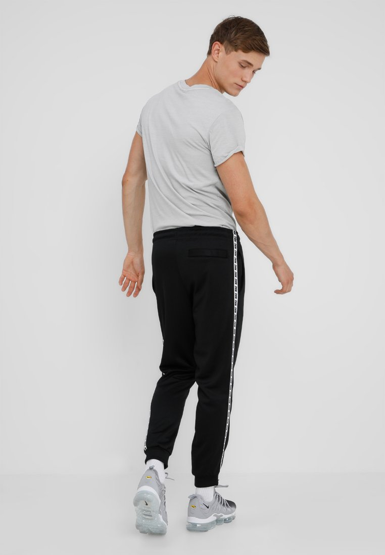 M NSW REPEAT Pantalon de survêtement blackwhite