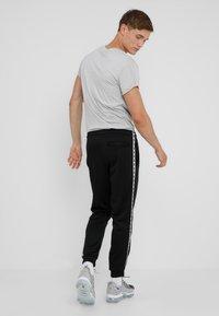Nike Sportswear - POLY - Pantalon de survêtement - black/white - 2