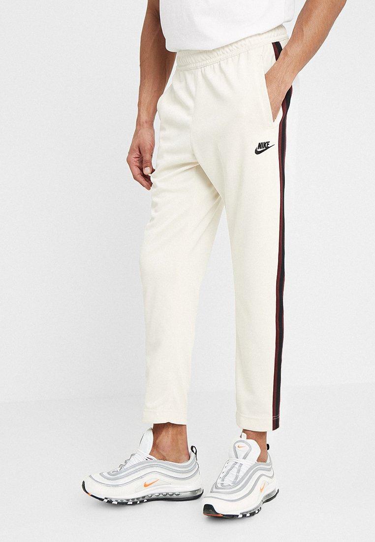 Nike Sportswear - PANT TRIBUTE - Tracksuit bottoms - light cream/sail