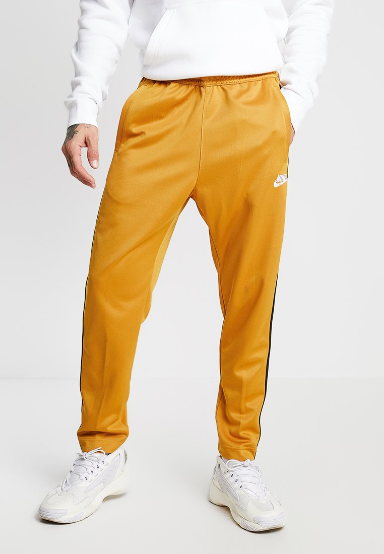Nike Sportswear - PANT TRIBUTE - Tracksuit bottoms - gold suede