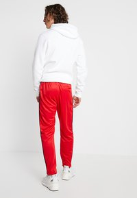 Nike Sportswear - PANT TRIBUTE - Träningsbyxor - university red - 2