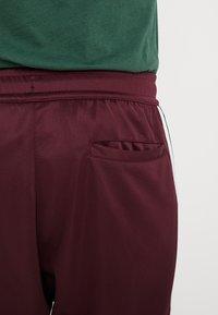Nike Sportswear - PANT TRIBUTE - Trainingsbroek - night maroon - 5