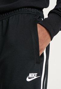 Nike Sportswear - PANT TRIBUTE - Spodnie treningowe - black/sail - 3