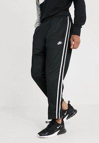 Nike Sportswear - PANT TRIBUTE - Spodnie treningowe - black/sail - 0