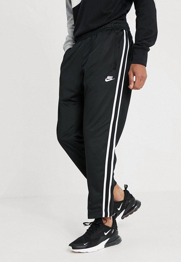 Nike Sportswear - PANT TRIBUTE - Spodnie treningowe - black/sail