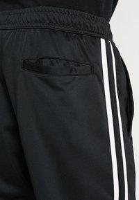 Nike Sportswear - PANT TRIBUTE - Spodnie treningowe - black/sail - 6