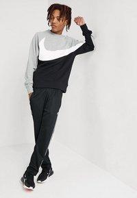 Nike Sportswear - PANT TRIBUTE - Spodnie treningowe - black/sail - 1