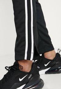 Nike Sportswear - PANT TRIBUTE - Spodnie treningowe - black/sail - 4