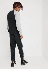 Nike Sportswear - PANT TRIBUTE - Spodnie treningowe - black/sail - 2