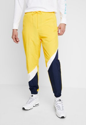 PANT - Tracksuit bottoms - amarillo/white/obsidian