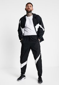 Nike Sportswear - PANT - Trainingsbroek - black/white - 1