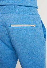 Nike Sportswear - HERITAGE - Tracksuit bottoms - battle blue - 3