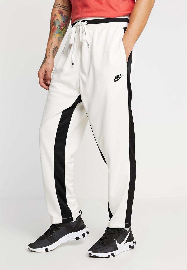 Nike Sportswear - AIR PANT - Teplákové kalhoty - sail/black