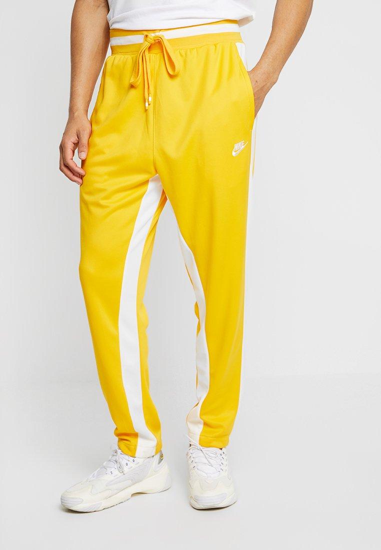Nike Sportswear - AIR PANT - Jogginghose - university gold/sail